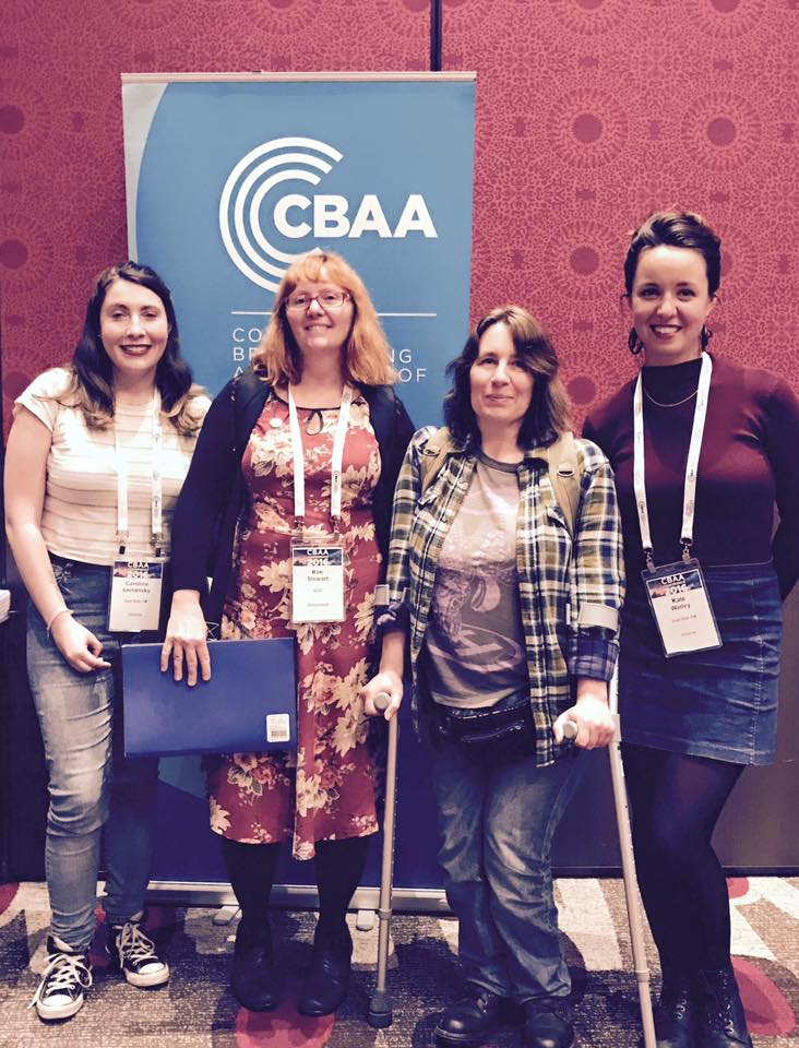 Photo graph of four women speakers from CBAA conference, one of whom is using walking aids