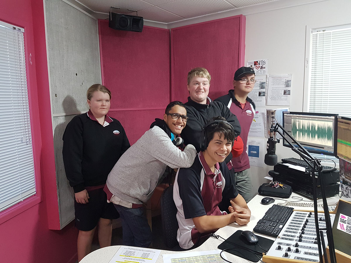 group of young people at a radio panel